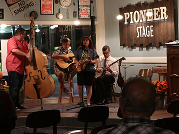 Musicians performing at the Pioneer Stage