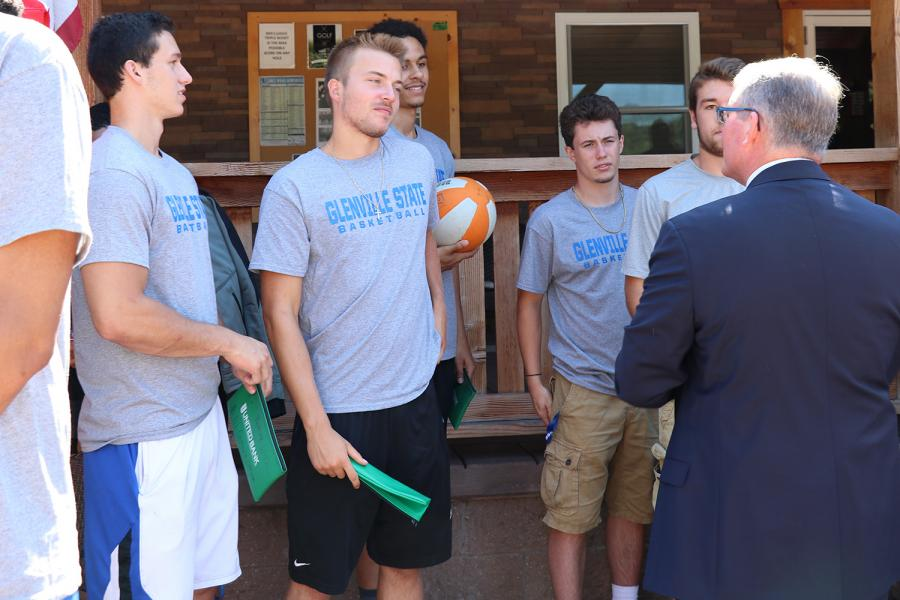 Members of the Men's Basketball team chat with Dr. Pellett during their golf outing fundraiser.