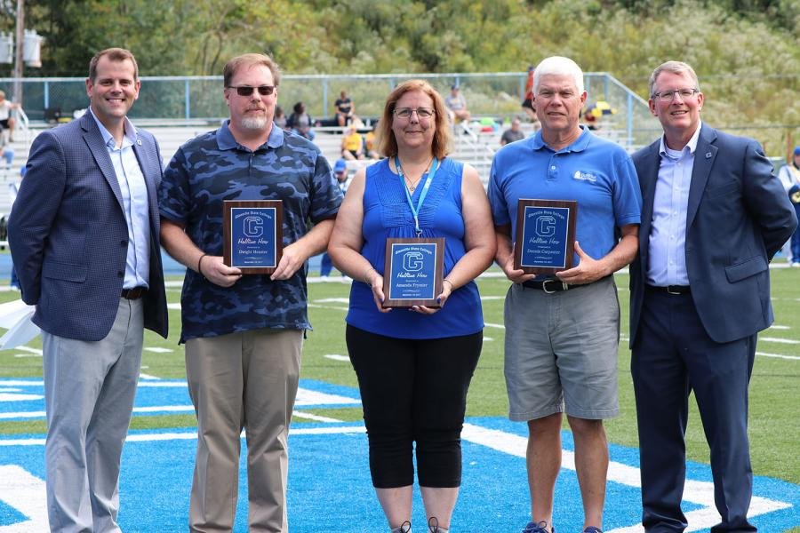 Dr. Pellett with the first group of Halftime Heroes; Dr. Dwight Heaster, Mandy Frymier, and Dennis Carpenter.