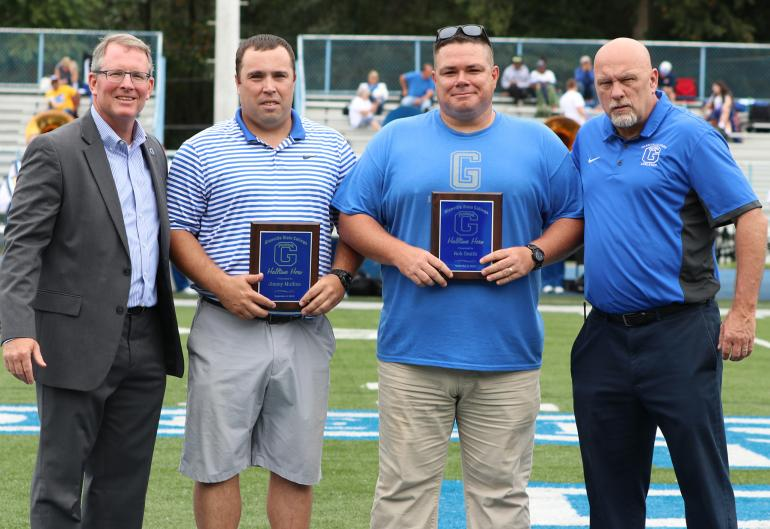 Rob Smith and Jimmy Mullins accept the Halftime Heros award