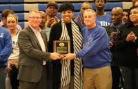 GSC President Dr. Tracy Pellett (left) and Former GSC Coach Tim Carney (right) presenting Sharon Minnieweather (center) with a plaque commemorating the event