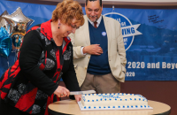 Interim President Dr. Kathy Nelson cuts the Founder's Day cake as part of the 2020 Day of Giving celebration earlier this year