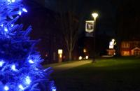 A tree decorated with Pioneer blue lights stands on Clark Hall Lawn