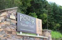 A three-dimensional sign, donated by Don and Glendora Hedley, marks the beginning of the Pioneer Nature Trail