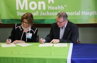 Stonewall Jackson Memorial Hospital CEO Avah Stalnaker and Glenville State College President Dr. Tracy Pellett sign the Memorandum of Understanding