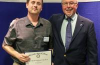 Glenville State College Staff Employee of the Year Jason Gum (left) with John Beckvold