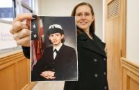Glenville State College student veteran Sabrina Gonzalez holds a service-era photo of herself