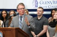 President Pellett, flanked by students, announces new initiatives to save students money at a Thursday press conference