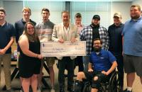 Glenville State College President Dr. Mark Manchin (center, holding check) is joined by Pioneer eSports students Aden Knopp, Adam Davis, Abigail Taylor, Noah Schultz, Justin Sodergren, Sterling Gandee, Chris Anglin, Austin Cochran and eSports Coach Logan Harrison.