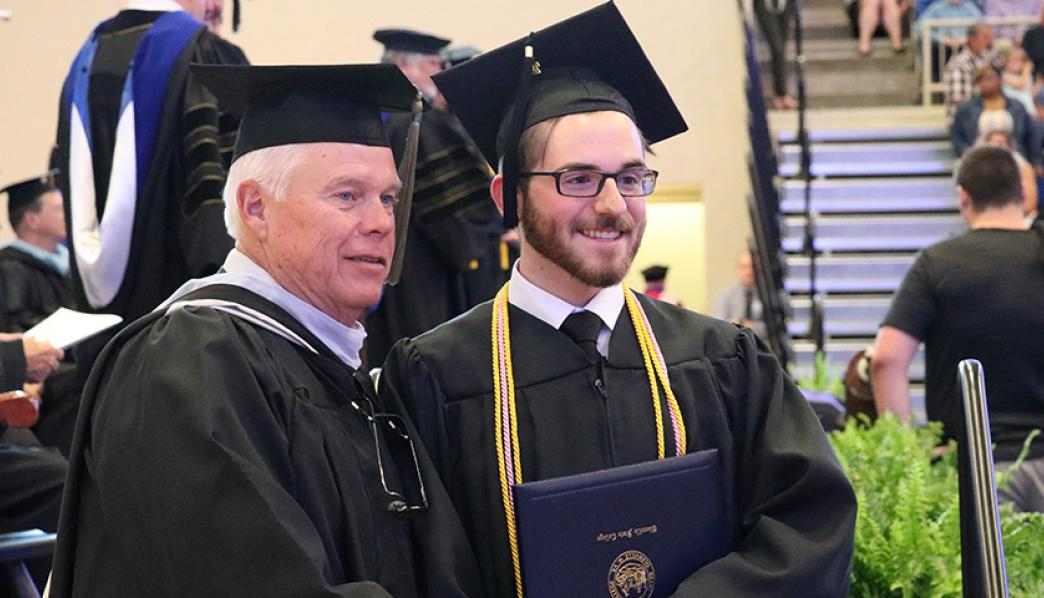 Clayton Swisher with Dennis Carpenter at Commencement