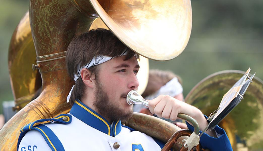 Gabe French performs with the Marching Band